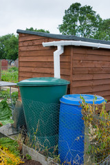 Water storage barrel with garden shed