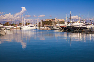 Antibes, France. View yachts moored in the city's port