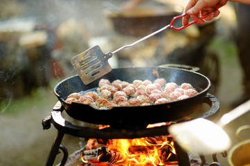 Meatballs on grill in the garden
