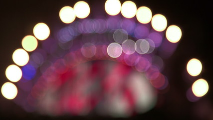 Flashing lights on the stage at  music concert out of focus