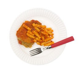 Breaded chicken and pasta TV dinner on paper plate with fork
