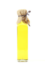 Olive oil in glass bottle on white background.
