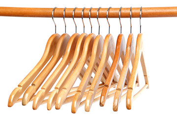 Wooden clothes hangers on the bar.
