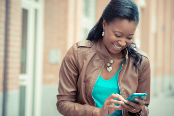beautiful african young woman using smartphone
