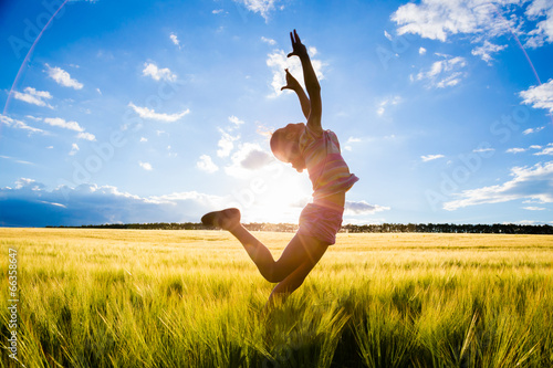 jumping kid on the field - 66358647