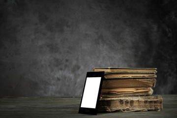 Smartphone (self-designed) and old yellowed books