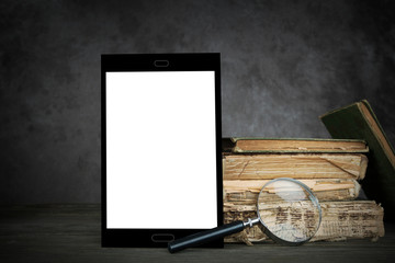 Old books, a self-designed tablet computer and a magnifier