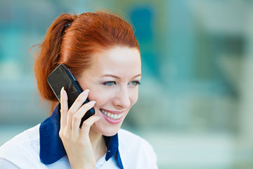 Happy, smiling businesswoman talking on cell phone