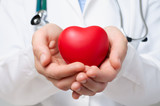 Doctor protecting a heart - 66359603