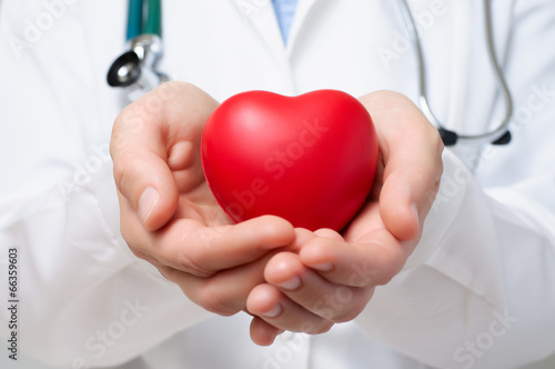 Doctor protecting a heart Plakat