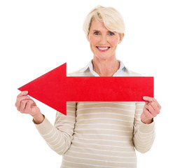 mature woman with red arrow