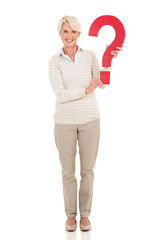 mid age woman holding question mark