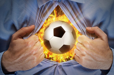 Burning soccer ball behind a shirt