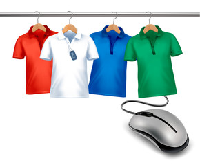 Different hangers with shirts and a computer mouse. Concept of e