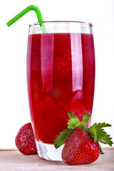 Domestic and fresh healthy strawberry juice on wooden table