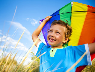 Cheerful Young Boy Playing Kite Outdoors