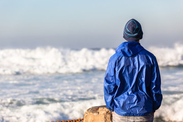 Teenager  Watching Ocean Waves Power