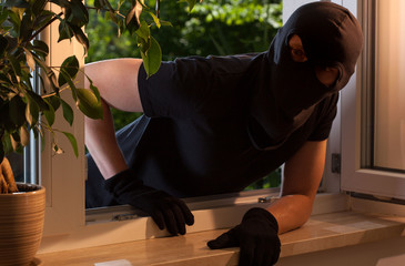 Burglar peeks into the house