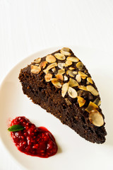 Chocolate cake decorated with almonds