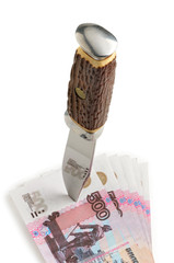 The dagger pierces banknotes Russian rubles on white background