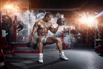 bodybuilder athletic guy execute biceps exercise with dumbbells