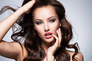 beautiful expressive woman with long brown hair