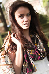 Beautiful brunette young woman outdoor