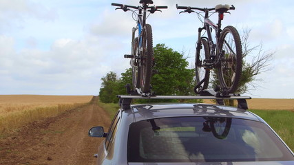Car with two bicycles mounted on bike roof carrier