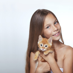 Kid girl with kitten