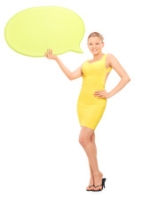 Elegant woman holding a speech bubble