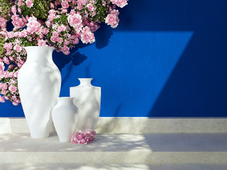 Vases in front of blue wall.