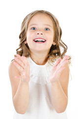 Portrait of surprised happy adorable little girl isolated