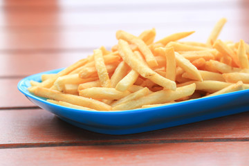 bowl of french fries on wooden table