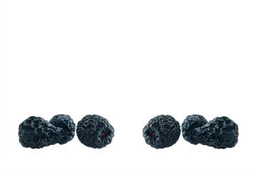 Dried aronia berries isolated on white