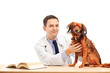 Veterinarian and a dog seated at a table