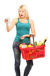 Shocked woman looking at the shopping bill