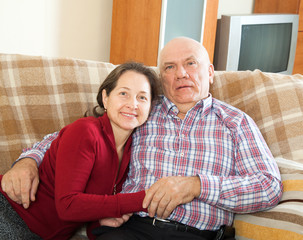 couple on sofa in home