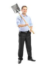 Young man posing with a shovel over his shoulder