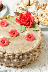 Cream cake with sugar red flowers