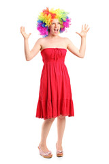 Woman wearing a wig and gesturing with hands