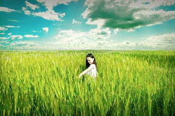 Little cute girl on wheat field