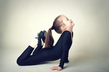 Happy little girl doing gymnastics