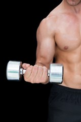 Strong crossfitter lifting up heavy dumbbell
