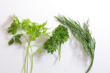 bunch of parsley and dill on a white background. healthy greens