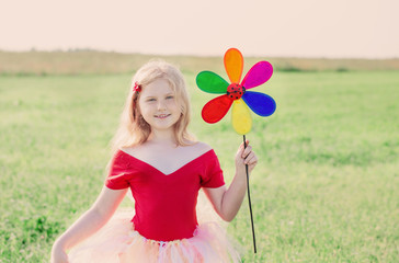 girl holding a toy flower