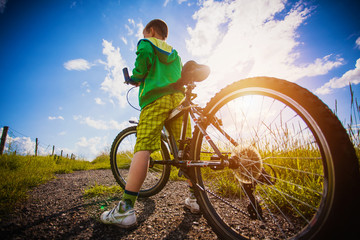little boy with his bicycle