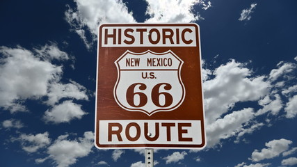 Route 66 Sign with Time Lapse Clouds