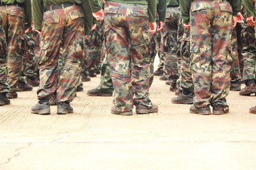 Soldiers in camouflage military uniform in rest position