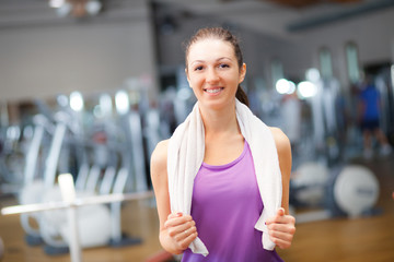 Portrait of a young woman in a gym