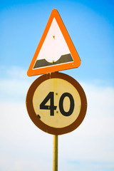 Bump ahead road sign,Maximum speed 40 km